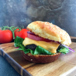 Keto Burger buns layered with burger patties, cheese and tomatoes