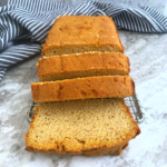 keto Pumpkin bread slices on a cooling rack with a dish cloth at the background