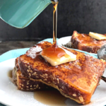 Keto French toast with butter on top and some drizzle of maple syrup