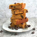 Keto pumpkin chocolate chip blondies stacked on top of one another