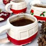 3 Christmas mugs filled with hot chocolate